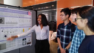 Kosa shows off her REU research