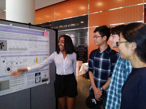 Kosa shows off her REU research